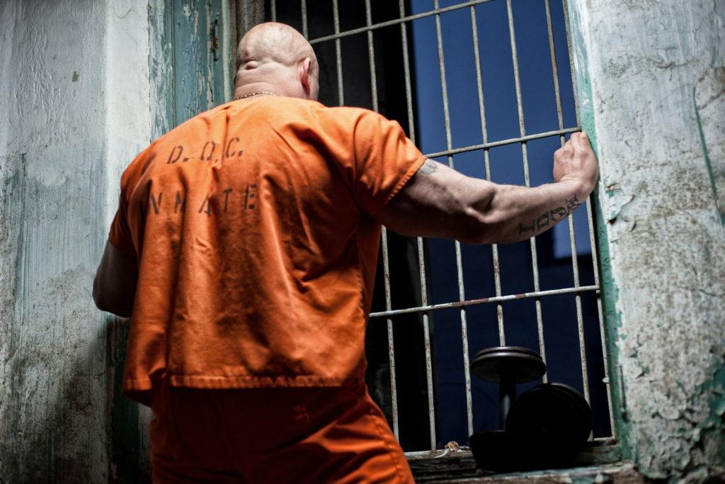 prison inmate in orange clothing