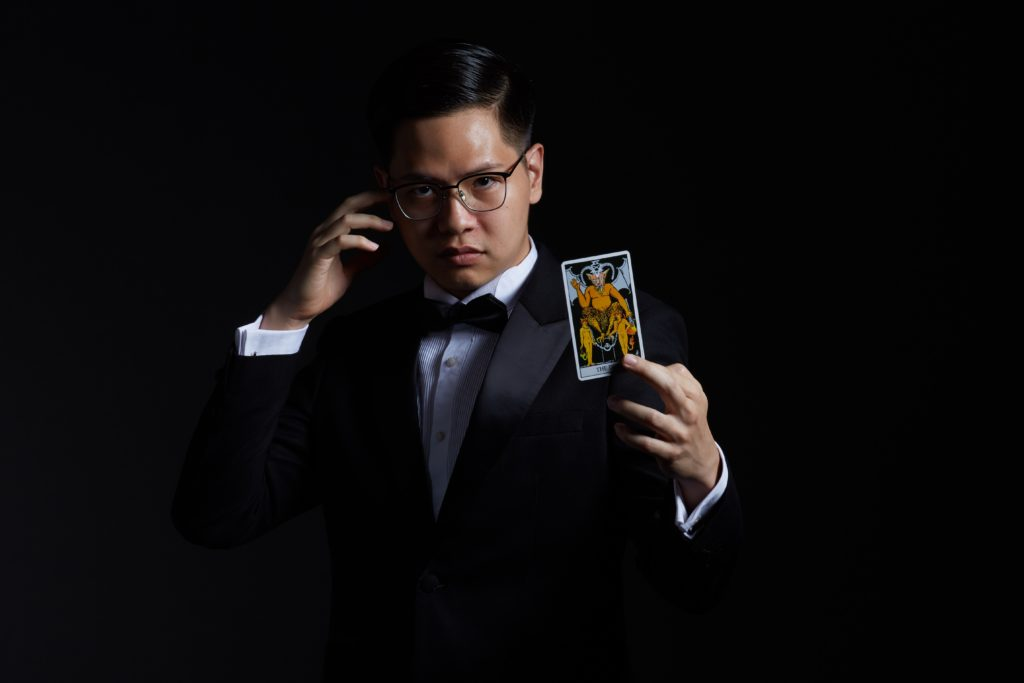 quantamentalist, man holding playing card