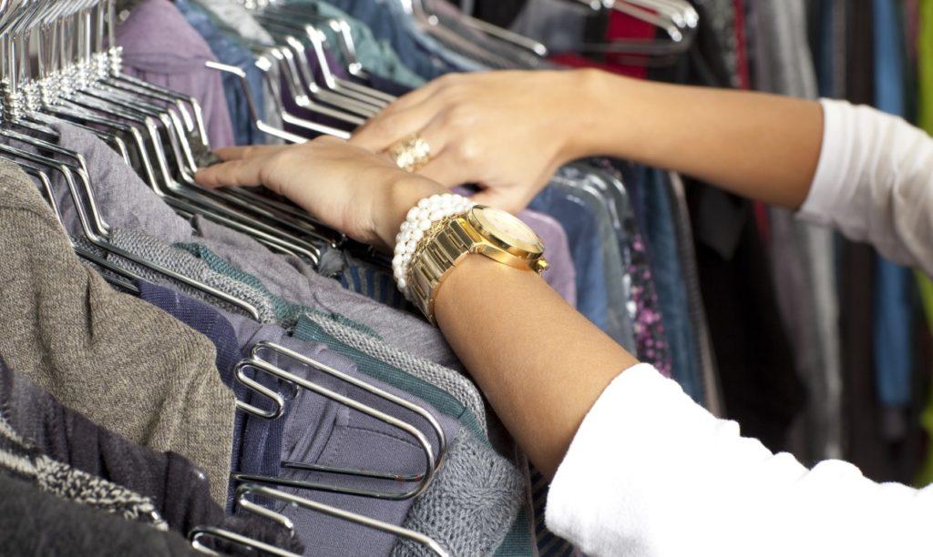 shopper looking thru department store merchandise