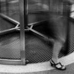 woman exiting revolving door