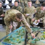 soldiers looking at 3d map